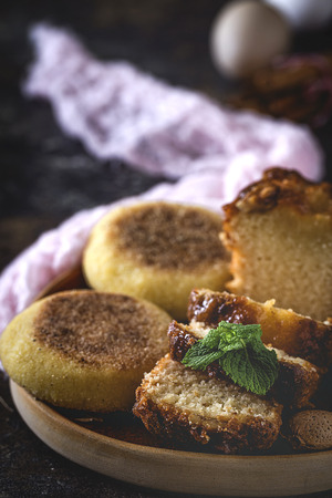 Homemade cinnamon cake and almonds on dark table. Oxide Stock Photo