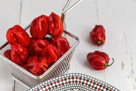 Fresh red peppers. On wooden table Stock Photo