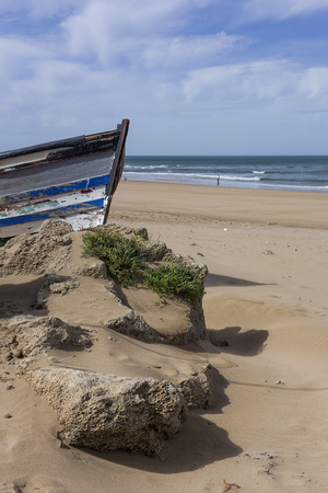 Typical wild beach in Tangier.Morocco. Wtith boat