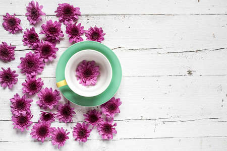 Cup of tea with Floral background and green leaves on white background. Flat lay, top view