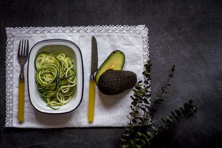 Fresh zucchini on a black background on old table Stock Photo