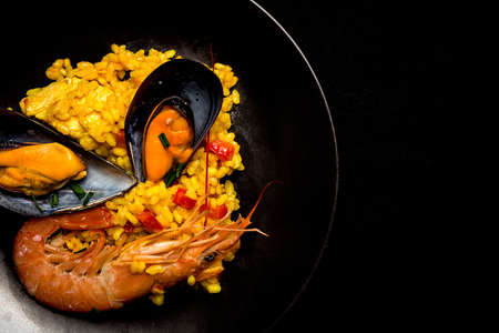 Traditional rice in paella with fish and meat. Typical Spanish