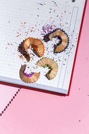 Back to school supplies, notebooks, colored pencils from above. Flat lay. Top view