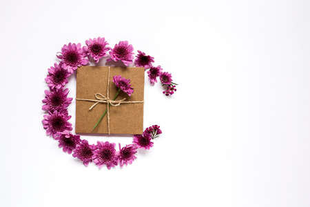 Gift box with string on white background