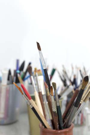Artist's brushes in a Jar in a painting studio Standard-Bild