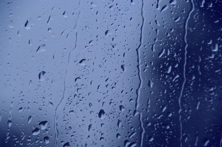 rainy day: blue window water drops flowing