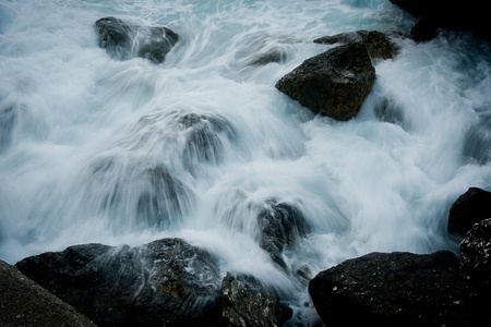 Rushing water water flowing over rocks photo