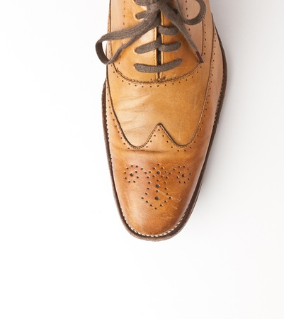 Tan fashionable male brogue shoes on white background  photo