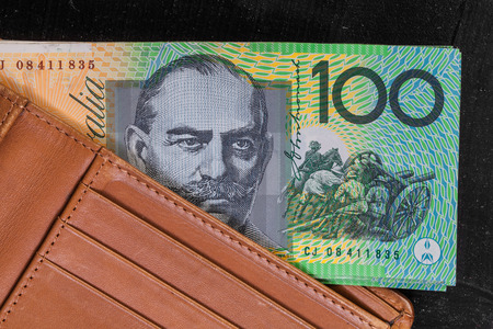 spendthrift: Australian currency in leather wallet