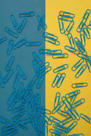 paper clips: Close-up of blue and yellow paper clips