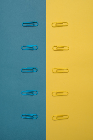 yellow paper: Close-up of blue and yellow paper clips