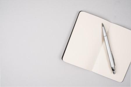 memorise: Blank open notebook with pen