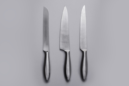 three objects: Stainless steel kitchen knife isolated over white background, set of three objects