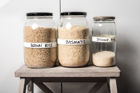 basmati rice: Raw Brown rice, basmati rice and jasmine rice variety in jars