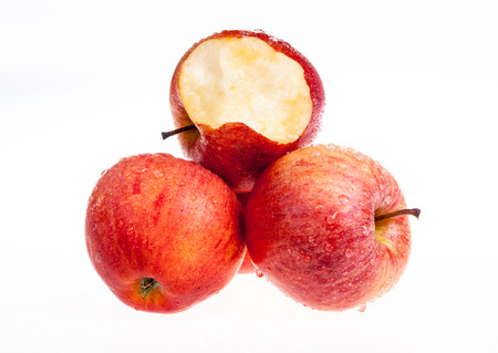biten: one red apple biten off with isolated background Stock Photo
