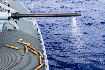 decommissioning: a fired cannon from a warship in sea