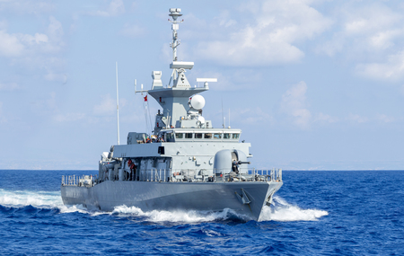decommissioning: a warship drives in sea