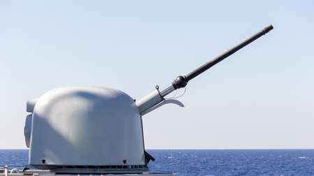 decommissioning: cannon of a warship aims to a target Editorial