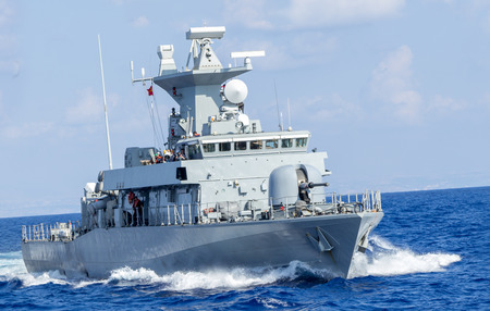 decommissioning: warship drives fast in ocean