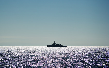 decommissioning: warship in ocean