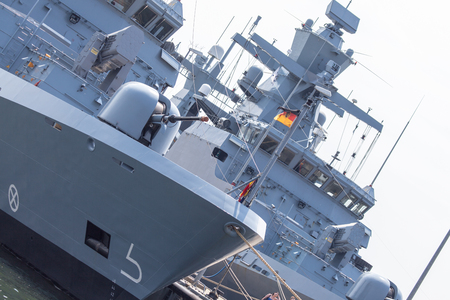 decommissioning: two german frigates on a harbor