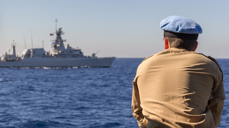 german warship captain looks to another warship