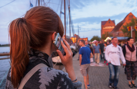 telephoning: telephoning woman with mobile phone in germany Stock Photo