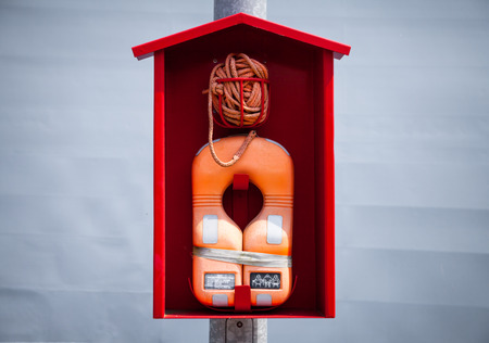 lifevest: orange lifevest lifebelt in a red cabin