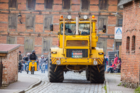 ALTENTREPTOW MECKLENBURG- WEST POMERANIA - MAY 2015: Russian Kirowez K 700 tractor drives on a oldtimer show through altentreptow germany at may 2015.
