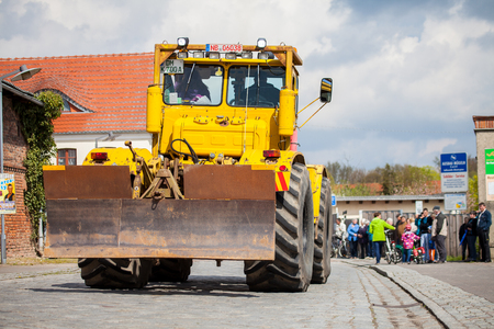 farm duties: ALTENTREPTOW MECKLENBURG- WEST POMERANIA - MAY 2015: Russian Kirowez K 700 tractor drives on a oldtimer show through altentreptow germany at may 2015.