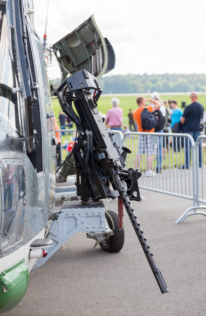 gunner: BERLIN  GERMANY - MAY 2014: machine gun on german  sea lynx  helicopter, on the ILA ( Internationale Luft- und Raumfahrtausstellung) Berlin Air Show in berlin at may 2014. Editorial