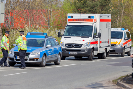 ALTENTREPTOW  GERMANY - 1. MAY 2016: german emergency ambulance and police vehicle stands on the street in altentreptow on may 2016.