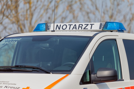 cross street with care: ALTENTREPTOW  GERMANY - 1. MAY 2016: german emergency ambulance (NOTARZT) car stands on the street in altentreptow on may 2016. Editorial