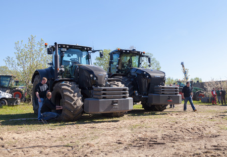 GRIMMEN GERMANY - MAY 5: german claas xerion and axion tractors stands on track on a motortechnic festival on may 5, 2016 in grimmen  Germany. Editorial