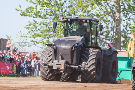 agricultural tenure: GRIMMEN GERMANY - MAY 5: german claas xerion tractor drives on track on a motortechnic festival on may 5, 2016 in grimmen  Germany. Editorial
