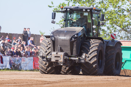 farm duties: GRIMMEN GERMANY - MAY 5: german claas xerion tractor drives on track on a motortechnic festival on may 5, 2016 in grimmen  Germany. Editorial