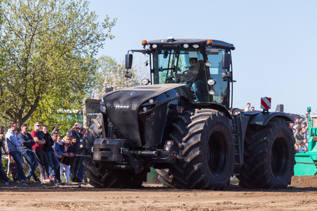 GRIMMEN GERMANY - MAY 5: german claas xerion tractor drives on track on a motortechnic festival on may 5, 2016 in grimmen  Germany. Editorial
