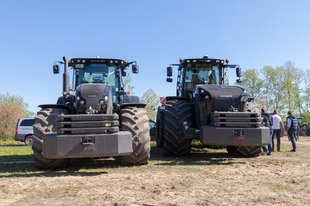 farm duties: GRIMMEN GERMANY - MAY 5: german claas xerion and axion tractors stands on track on a motortechnic festival on may 5, 2016 in grimmen  Germany. Editorial
