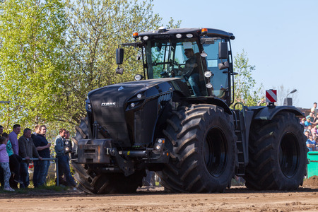 tenure: GRIMMEN GERMANY - MAY 5: german claas xerion tractor drives on track on a motortechnic festival on may 5, 2016 in grimmen  Germany. Editorial
