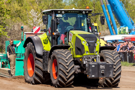 tenure: GRIMMEN GERMANY - MAY 5: german claas axion tractor drives on track by a traktor pulling event on may 5, 2016 in grimmen  Germany.
