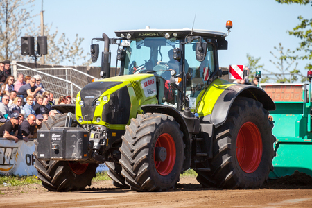 treck: GRIMMEN GERMANY - MAY 5: german claas axion tractor drives on track by a traktor pulling event on may 5, 2016 in grimmen  Germany.