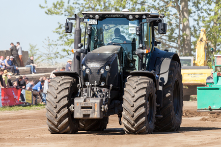 farm duties: GRIMMEN GERMANY - MAY 5: german claas axion tractor drives on track by a traktor pulling event on may 5, 2016 in grimmen  Germany.