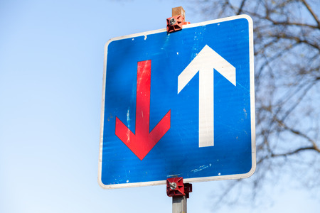 precedence: traffic sign narrowed roadway precedence over the oncoming traffic Stock Photo