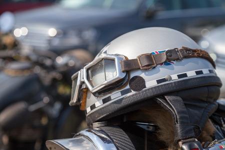 oldtimer motorcycle helmet lies on motorcycle