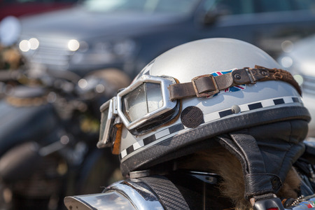 oldtimer motorcycle helmet lies on motorcycle