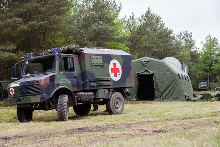 MUNSTER  GERMANY - MAY 2012: german military ambulance stands on rescue center system in a wood on may 2012 in munster, germany.