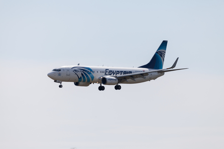 boing: BERLIN  GERMANY - AUGUST 1, 2015: Boing 737 - 800, EgyptAir plane lands on airport tegel at august 1,2015 in berlin  germany.