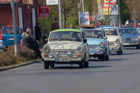 est: ALTENTREPTOW  GERMANY - MAY 1, 2016: german trabant car drives on a street at oldtimer show on may 1, 2016 in altentreptow, germany.