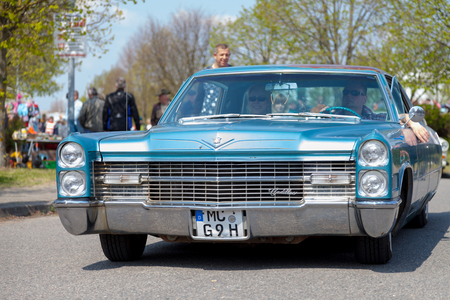 ville: ALTENTREPTOW  GERMANY - MAY 1, 2016: Cadillac Coupà© de Ville drives on street at at oldtimer show in old treptow  germany on may 1, 2016th
