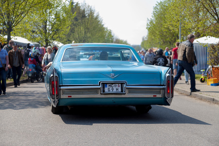 ALTENTREPTOW / GERMANY - MAY 1, 2016: Cadillac Coupé de Ville  drives on street at an oldtimer show in altentreptow / germany on may 1, 2016.
